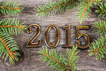 New Year frame with  fir decorations on old wooden background
