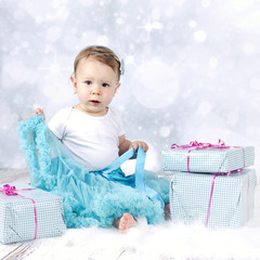 Little baby girl with christmas presents