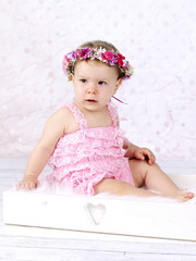 Little baby girl with floral wreath