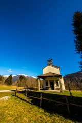 church in the meadows of Alps