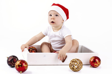 Little baby with christmas balls