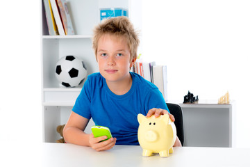 boy with piggy-bank and phone