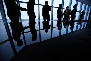 Group of business people standing against office