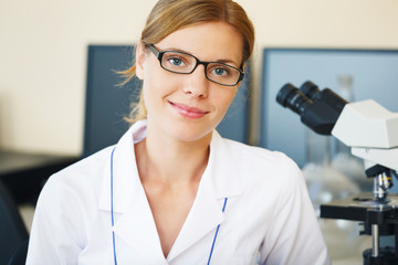Portrait of beautiful young woman in a laboratory.