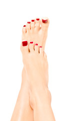 Beautiful well-groomed female feet with red pedicure