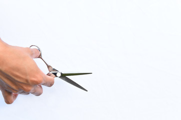 Hair's scissors in hands isolate on white background