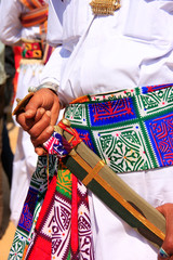 Close up of hands holding sword during Mr Desert competition, Ja