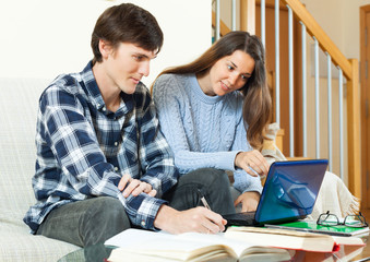 Student guy with girl preparing for session with electronic book