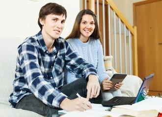 Happy couple preparing for exams