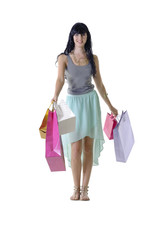 Young pretty shopping girl with colorful parcels