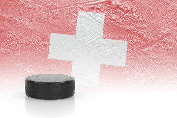 Hockey puck and the Swiss flag