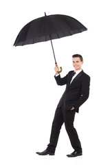 Insurance agent holding an umbrella