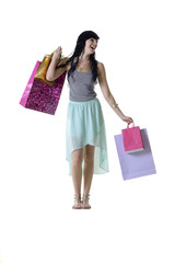 Young beautiful girl with shopping parcels isolated on white