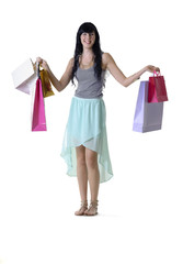 Young hppy girl with shopping bags isolated on white