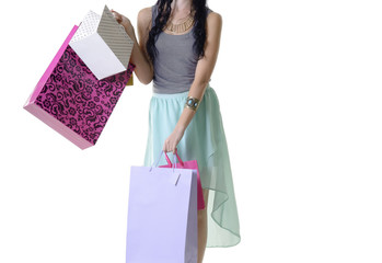 close up of woman holding colourful shopping bags