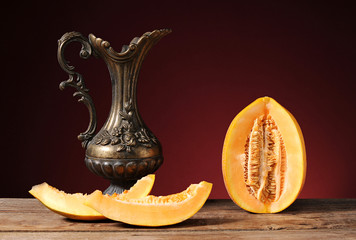Fresh excised melon and carafe of metal