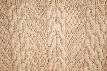 Background texture of knitted yellow pullover