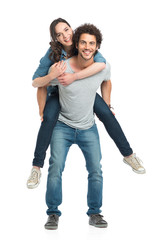 Man Giving Piggyback Ride To Her Girlfriend