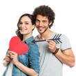 Loving Couple Holding Arrow And Heart