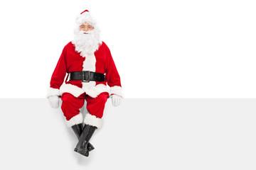 Santa Claus sitting on a blank billboard