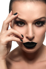 Beauty female model with black caviar on his lips