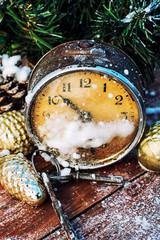 broken alarm clock and Christmas decorations