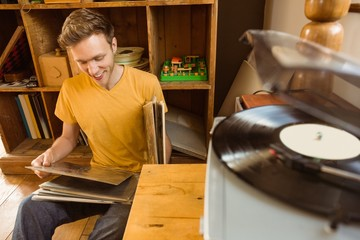 Young man looking at his vinyl collection