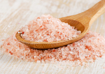 pink salt in a  wooden spoon