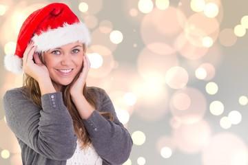 Composite image of festive blonde smiling at camera