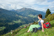 Woman in Dirndl enjoys the mountains