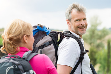 Mature Man Hiking With Wife