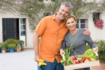 Mature Couple With Organic Vegetables