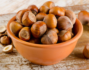 Hazelnuts on a old wooden background