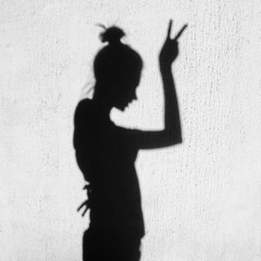 Shadow of girl showing victory by finger