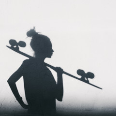 Photo of shadows of girl with a skateboard