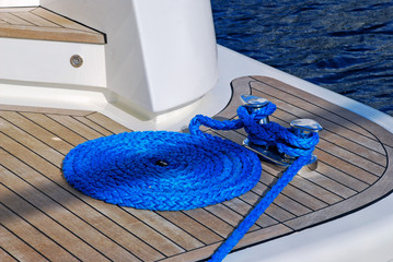 Blue rope coiled on a wooden deck