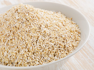 Healthy Oat bran on  wooden table