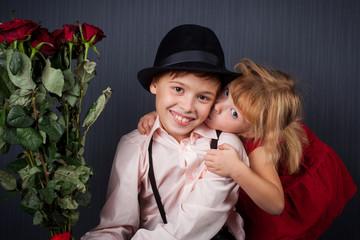the girl kisses the boy