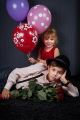 beautiful boy and the girl together with balloons