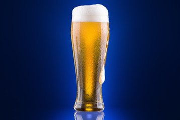 Frosty glass of light beer