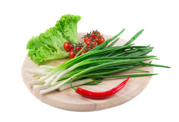 Fresh vegetables and spices on cutting board