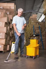 Man moping warehouse floor