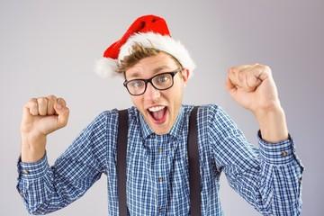 Geeky hipster wearing santa hat