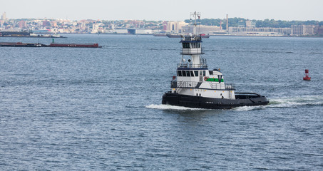 Green and White Tug Boat in New York Harbor