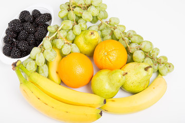 Oranges Blackberries Grapes Bananas and Pears on White
