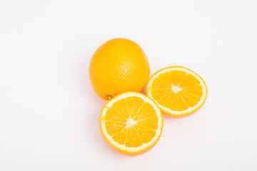 Whole and Half Oranges on White