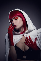 Mysterious sensual vampire girl with red lips
