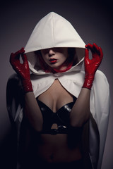 Portrait of sensual vampire girl with red lips