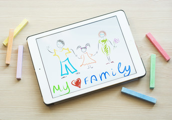 Kid drawing on the tablet