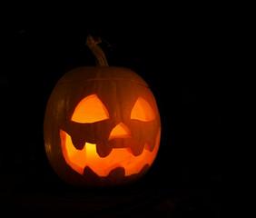 Alone pumpkin head in the darkness